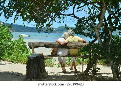 Happy elderly couple rest at tropical resort