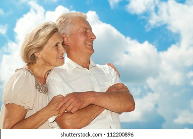Happy elderly couple went for a walk on the nature