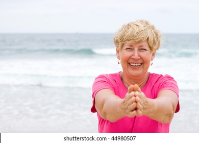 happy elderly doing fitness working out on beach
