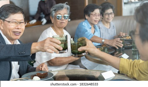 Happy elderly family senior people society lifestyle concept. Ageing Asia women having dinner on dining table together in hospice older wellbeing nursing home community.