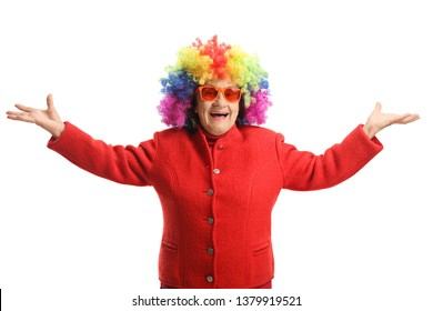 Happy elderly lady with a red coat and a colorful wig isolated on white background