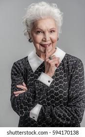 Happy elderly lady spending time with joy