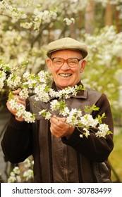 Happy elderly man in the garden