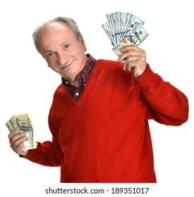 Happy elderly man holding dollar bills on a white background