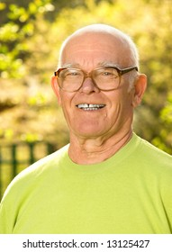 Happy elderly man outdoors