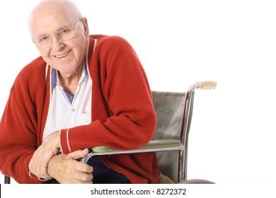 happy elderly man in wheelchair