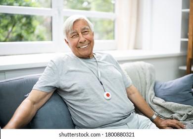 Happy Elderly Senior With Emergency Alarm Button