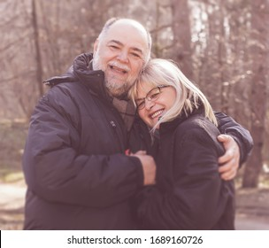 Happy Elderly Senior Romantic Couple in nature, Old people portrait outdoor winter autumn season.