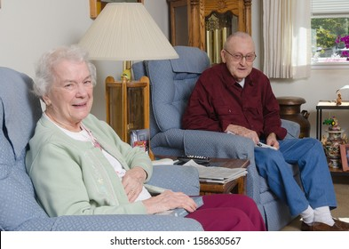 A happy elderly welcomes the viewer to their home.