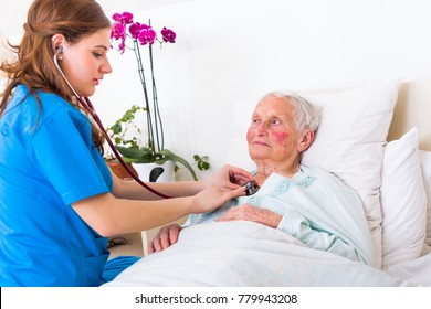 Happy elderly woman assisted by geriartric doctor, examination in the nursing home.
