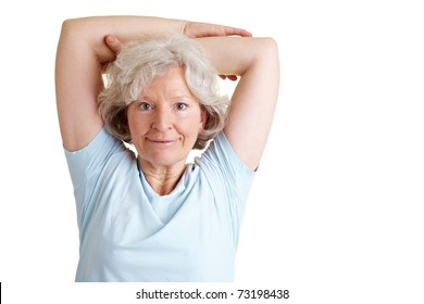 Happy elderly woman exercising her back with gymnastics