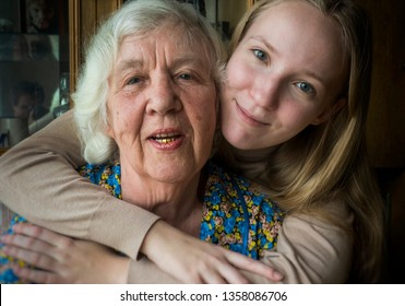 Happy elderly woman and her daughter or granddaughter