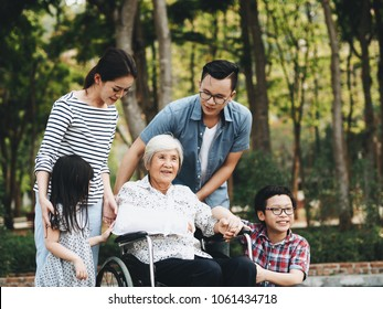 Happy Elderly woman with her family at the garden,They are talking and walking together.