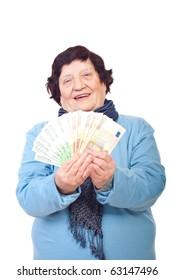 Happy elderly woman holding Euro banknotes isolated on white background