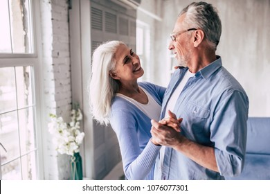 The happy elderly woman and a man dancing