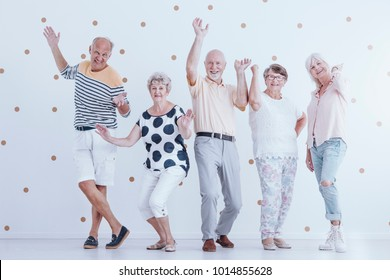 Happy elders having some fun at a New Year's Eve party