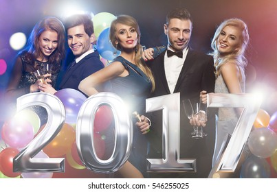 Happy elegant friends at New Year's eve