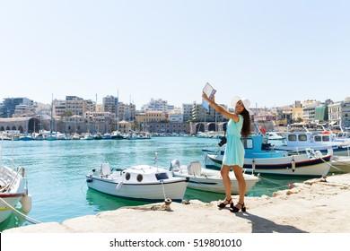 Happy elegant girl on sightseeing tour to Heraklion, Crete, Gree