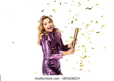 happy elegant woman in sequin dress with Party popper under falling confetti isolated on white