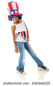 A happy elementary girl sporting her American patriot colors.  On a white background.