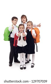Happy elementary school kids group with thumbs up - isolated