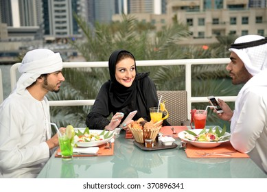 Happy Emirati arab family dining in a restaurant in Dubai
