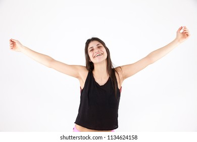 Happy emotional girl on a light background