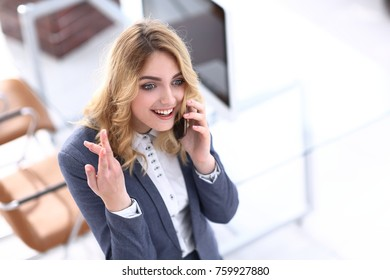 happy employee is talking on the smartphone