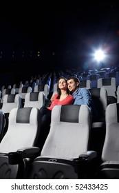The happy enamoured couple looks cinema