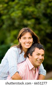 happy and energetic couple portrait outdoors with plenty of copyspace