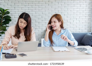 Happy entrepreneur asian businesswomen using smartphone dealing negotiate for startup business. Two partners enjoy good news from smartphone teamwork collaboration asian woman working together