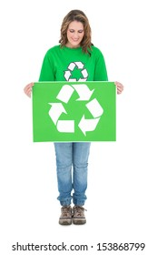 Happy environmental activist holding recycling sign on white background