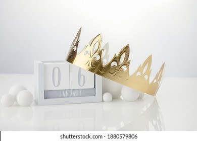 Happy Epiphany day, three kings day. Calendar with king crown on white background
