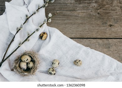 Happy Ester! Easter eggs and Easter decorations lying on wooden rustic table