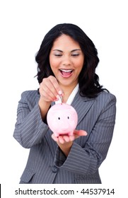 Happy ethnic businesswoman saving money in a piggy-bank isolated on a white background