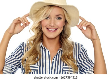 Happy European young woman in sun hat with long blond hair and highlights.