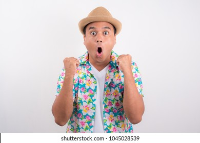 Happy excited asian man. He wearing summer shirt in Songkran festival Thailand concept.