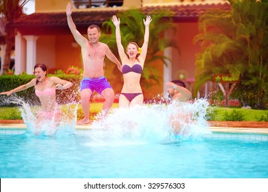happy excited friends jumping together in pool, summer fun