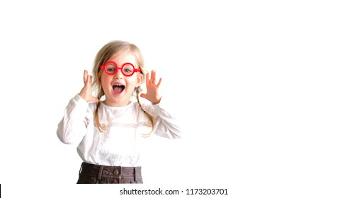 Happy excited little girl child wearing glasses and making a surprised expression, isolated on white background.