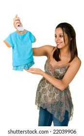 A happy excited pregnant woman is holding baby clothes for her new baby. Isolated on white.