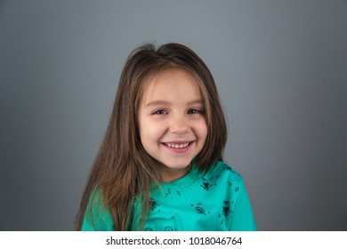 Happy and excited pretty caucasian girl model