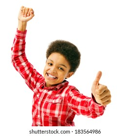 Happy excited school boy showing thumbs up. African american teenager with both hands showing enthusiasm isolated on white background, half body portrait.