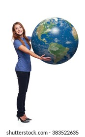 Happy excited woman in full length holding earth globe in her hands, American continent in front, over white background