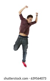 Happy and excited young asian man jumping and waving his arms gesturing success; isolated on white background