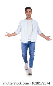 happy excited young casual man walking and welcoming you on white background