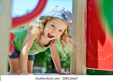 happy face of toddler on the playground