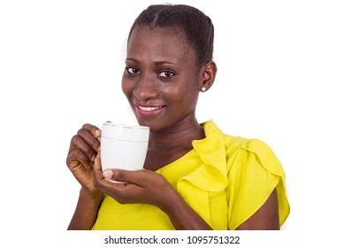 Happy face of young woman drinking coffee indoors.