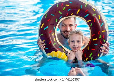 Happy faces looking through pool float, summer vacation