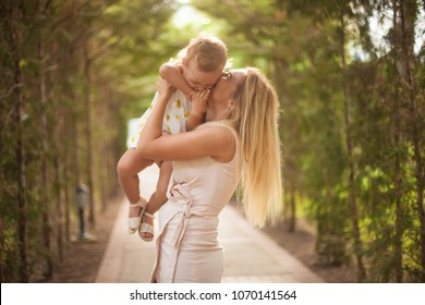 Happy family, active mather with little child, adorable toddler girl
