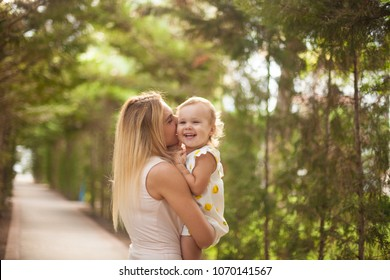 Happy family, active mother with little child, adorable toddler girl